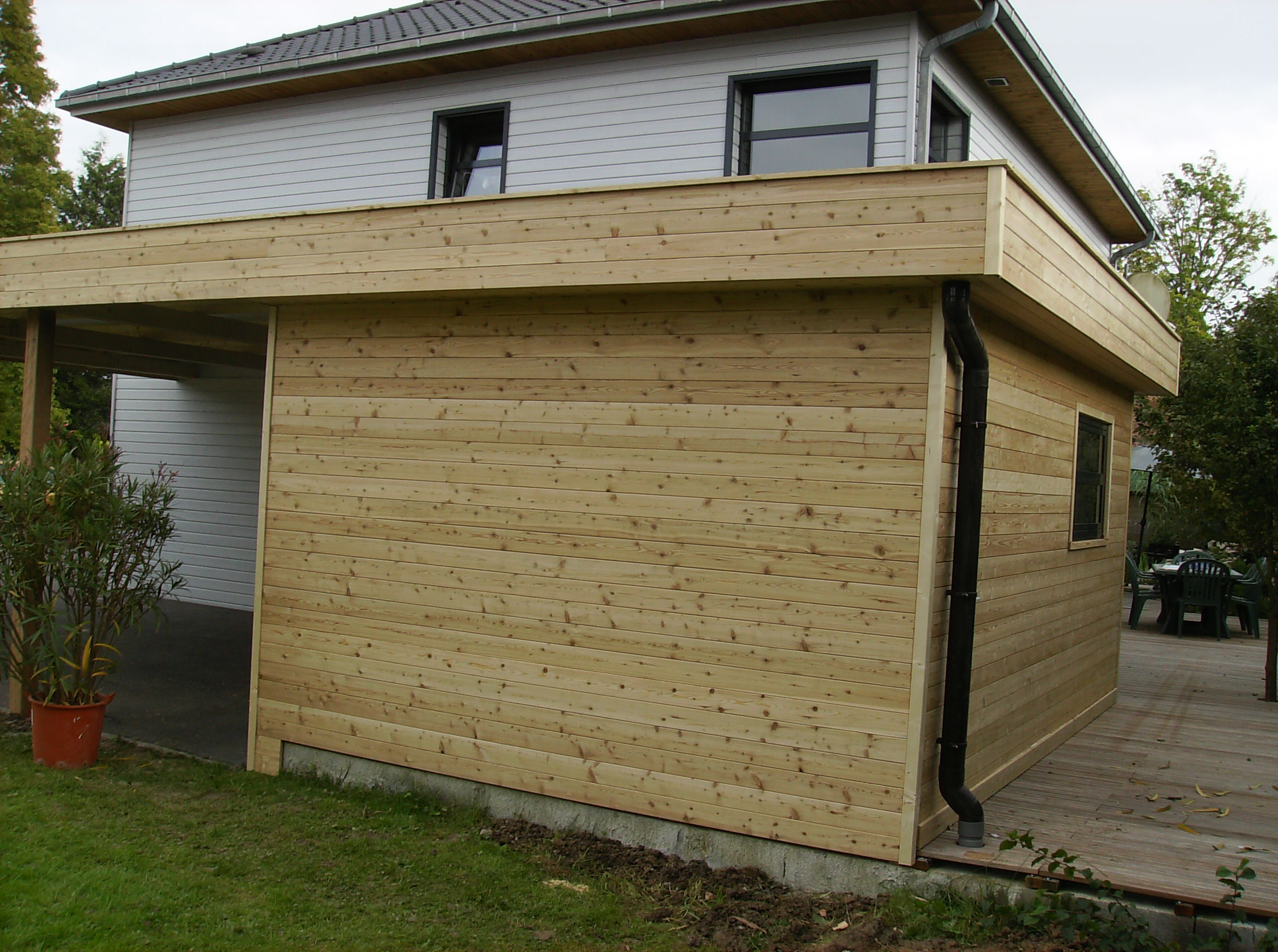 Abris toit plat daniel decadt houten constructies houthandel proven - Abri de jardin toit plat tek ...